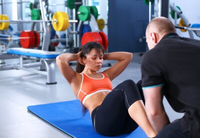 Cuadro A young woman with her coach at the gym