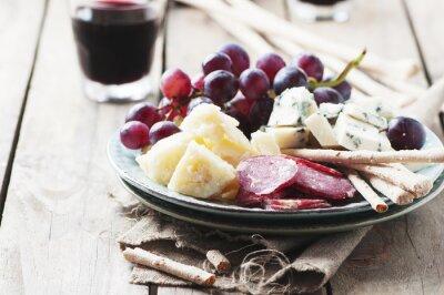 Cuadro Antipasto con queso, embutidos y uva