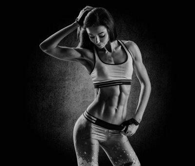 Cuadro atractiva mujer de fitness, cuerpo femenino entrenado, estilo de vida portrai