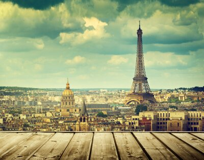 Cuadro background with wooden deck table and Eiffel tower in Paris