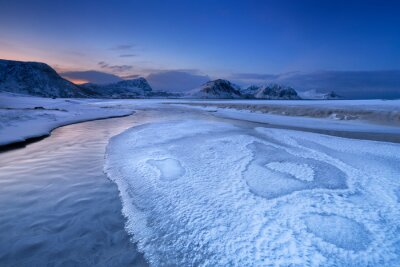 Beach and mountains on the Lofoten in Norway in winter