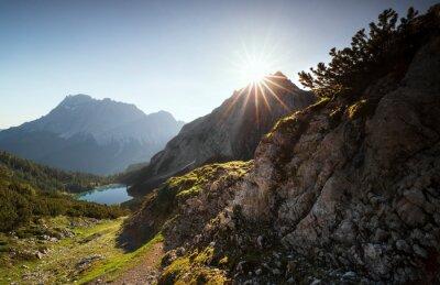 beautiful sunrise over mountain peaks and lake