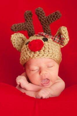 Cuadro Bebé recién nacido El uso de un reno con la nariz roja del sombrero