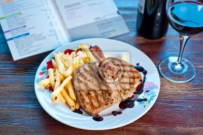 bistec con papas fritas
