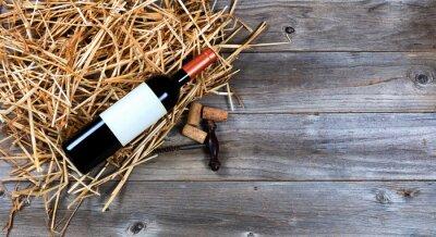 Cuadro Botella de vino tinto con vino vintage sacacorchos en la paja