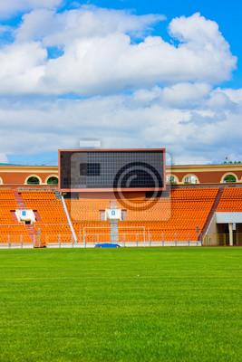 campo de fútbol con el tablero de puntuación