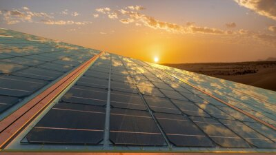clean energy concept, photovoltaic panels in the light of the rising sun