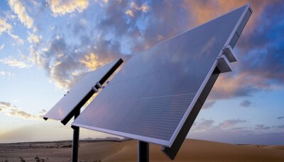 clean energy concept, photovoltaic panels in the light of the rising sun.