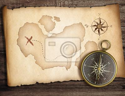 Cuadro Concepto Adventure. Viejo compás en la mesa con el mapa del tesoro.