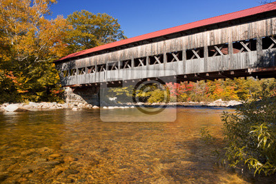 Covered bridge, river and fall foliage, Swift River, NH, USA