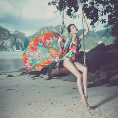 Cuadro Dama brillante en la playa