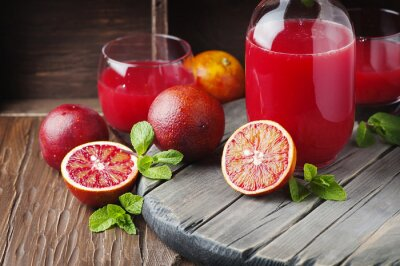 Cuadro Delicioso jugo con naranjas rojas y menta