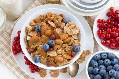 Cuadro Desayuno con cereales copos, nueces y bayas, vista superior