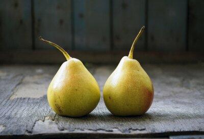 Cuadro Dos gemelos amarillos de la pera en suelo de madera, todavía vida