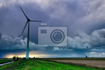 dramatic storm over wind turbines in summer