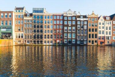 Cuadro Edificios a lo largo del Damrak durante el día en Amsterdam