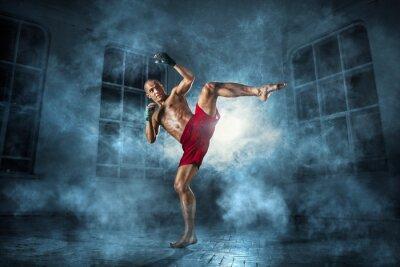 Cuadro El hombre joven kickboxing
