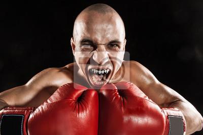 Cuadro El joven kickboxing en negro con kapa en la boca