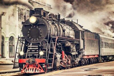 Cuadro El tren retro del vapor sale de la estación.