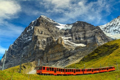 Cuadro Famous electric red tourist train coming down from the Jungfraujoch station(top of Europe) in Kleine Scheidegg,Bernese Oberland,Switzerland,Europe