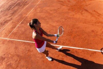 Cuadro Female tennis player serving a tennis ball