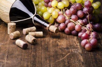 Cuadro Fiasco di con vino uva e turaccioli su tavola di Legno
