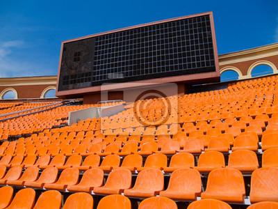 fila de asientos y tablero de la cuenta en el estadio de fútbol