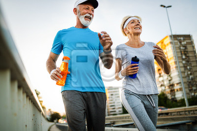 Cuadro Fitness, sport, people, exercising and lifestyle concept - senior couple running