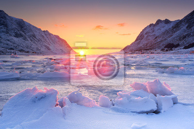 Frozen fjord in northern Norway in winter at sunrise