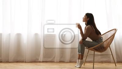 Cuadro Girl Sitting in Armchair And Enjoying Coffee