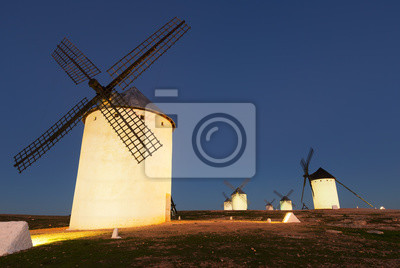 group of windmills in night