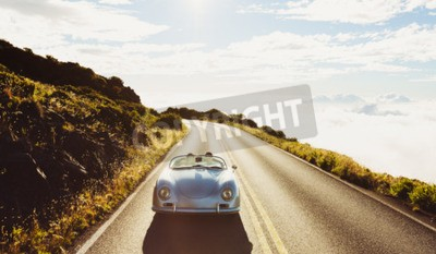 Cuadro Happy Couple Driving on Country Road in Classic Vintage Sports Car