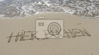 Hier buchen als Text in Sandstrand gezeichnet