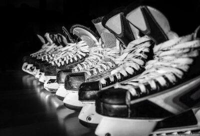 Cuadro Hockey skates lined up in locker room
