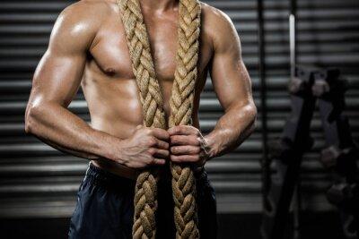 Cuadro Hombre sin camisa con cuerda de batalla alrededor del cuello