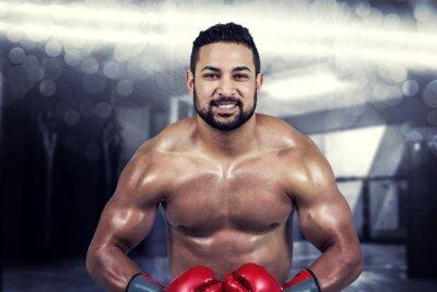 Cuadro Imagen compuesta de hombre musculoso boxeo en guantes