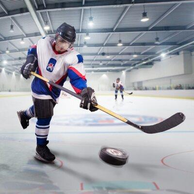 Cuadro Jugador de hockey dispara el puck y ataques