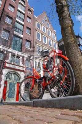 Cuadro La ciudad de Amsterdam con la bici contra casas en Holanda