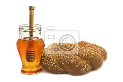 La miel y el pan en el fondo blanco