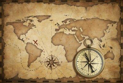 Cuadro latón envejecido antigua brújula náutica y viejo mapa con la pista en la que