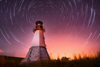 Cuadro lighthouse with night sky at background stars trails