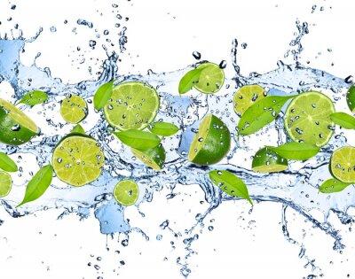 Cuadro Limas frescas en salpicaduras de agua, aislados en fondo blanco