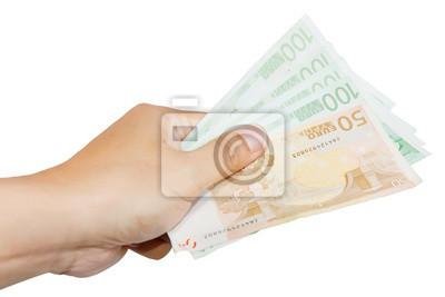 Mano que sostiene billetes de banco
