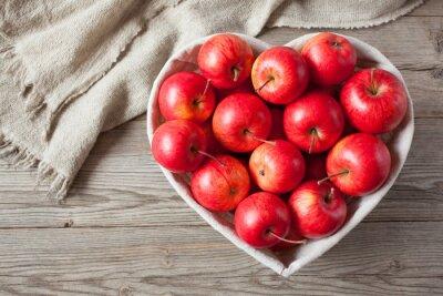 Cuadro Manzanas rojas sobre una mesa
