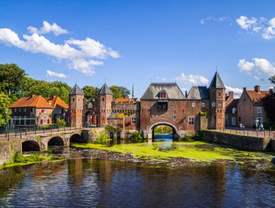 Medieval brick, city gate over the water on a beautiful sunny day