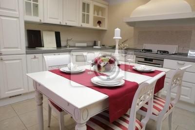 Cuadro: Mesa servida en el interior de la cocina moderna