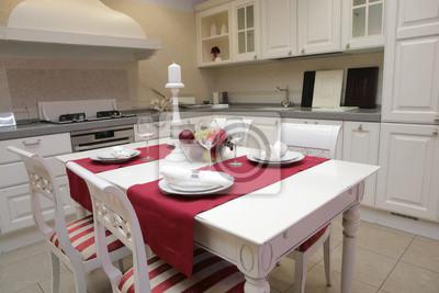 Mesa servida en el interior de la cocina moderna pinturas para la ...