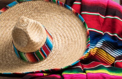 Cuadro Mexican Sobrero and Serape blanket on yellow background with cop