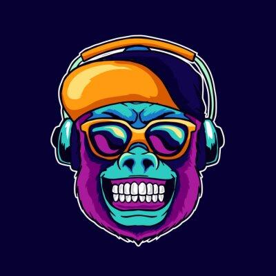 Cuadro Monkey smile wear cool glasses and cap hat listening dope music on the headphone speaker vector illustration. Pop art color style animal gorilla head logo design for creative DJ sound producer studio.