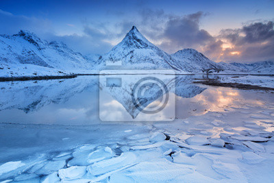 Mountain reflected in a fjord in Norway in winter